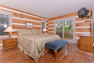 Pigeon Forge Two Bedroom Master Bedroom Cabin featuring a King Size Bed