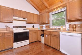 Pigeon Forge Two Bedroom Cabin that features a large Fully Equipped Kitchen