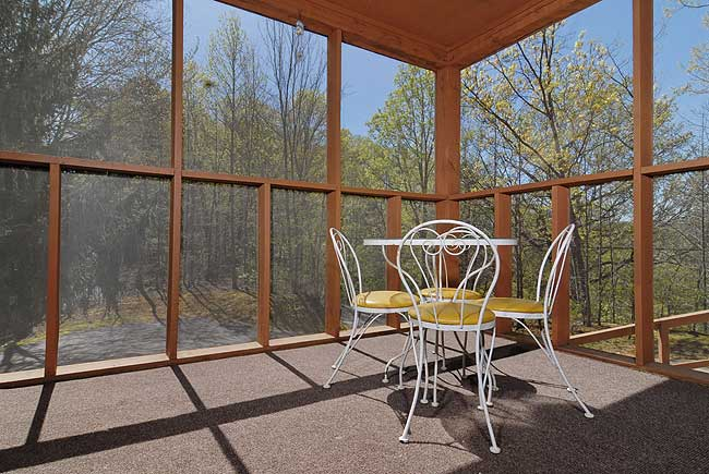 patio furniture on a screened in porch