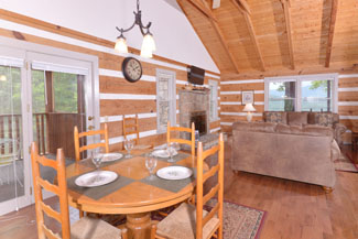 Pigeon Forge Cabin Rental that features a Rustic Cabin Living Room and Kitchen