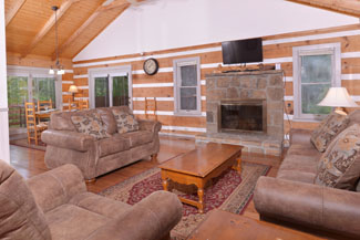 Pigeon Forge Two Bedroom Cabin Rental that features a woodburning fireplace and flat screen television