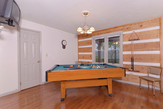 Pigeon Forge Two Bedroom Cabin Rental that features a gameroom that has a view of the Great Smoky Mountains and has its own Gameroom