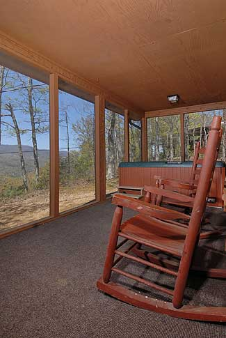 screened in porch with a hot tub
