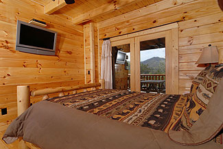 cabin bedroom with deck access