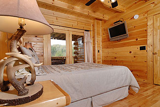flat screen television in cabin bedroom