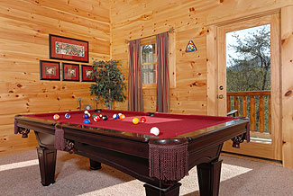deluxe gameroom with a pool table