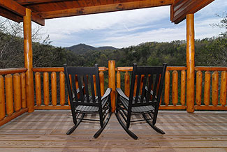 rocking chairs with a mountain view
