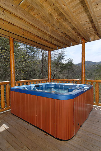 cabin hot tub overlooking a view