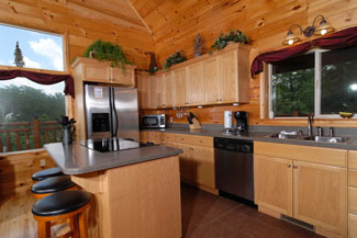 Pigeon Forge Two Bedroom Plus Loft Cabin Rentals with seating for 9 in the kitchen area