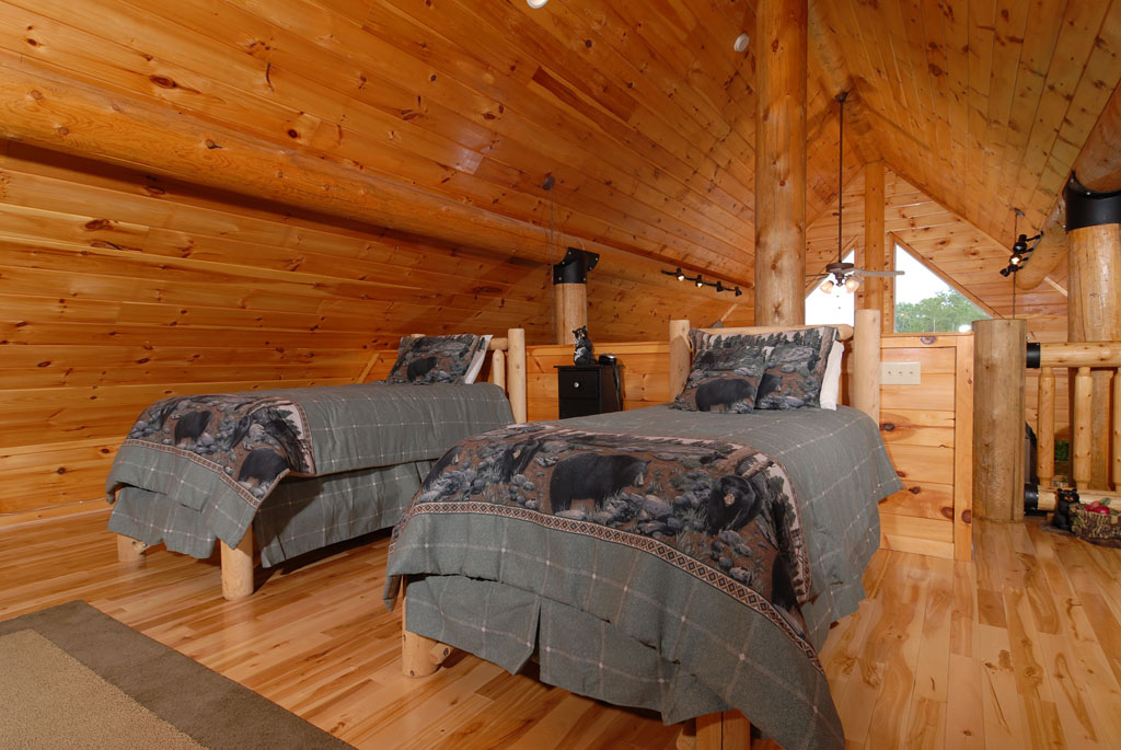Pigeon Forge Cabin that features twin beds in the upper level loft area