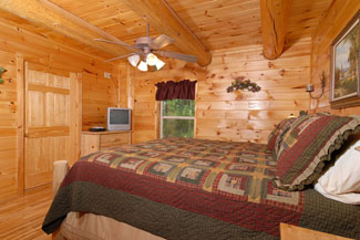 Pigeon Forge Cabin That offers a large master bedroom that has tv and dvd player