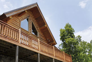 Tennessee Vacation Cabin Rental that is a Two Bedroom Plus a Loft Bedroom Log Cabin located in the woods but still convenient to area attractions