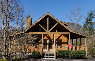 Pigeon Forge One Bedroom Plus Loft Cabin Rental Featuring a King Size Bed in the Main Level Master Bedroom