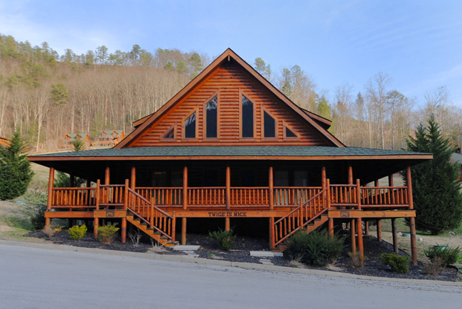 Pigeon Forge Two Bedroom Cabin Rental that has two master Suites,two indoor whirl pools, 2 outdoor hot tubs, and two firepits