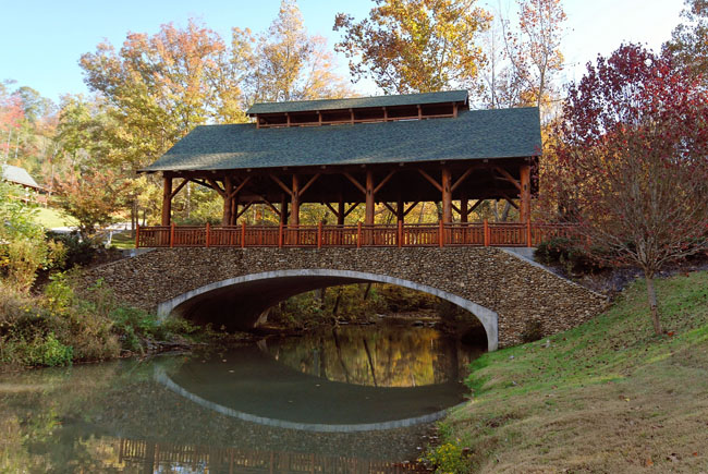 Covered bridge over a peaceful river