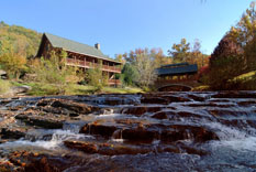 Pigeon Forge Deluxe 6 bedroom cabin on the river near a waterfall and a bridge near the Great Smoky Mountains National Park