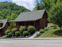 Pigeon Forge Cabin that Features Seasonal Outdoor Swimming Pool Access