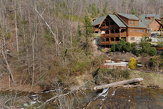 Pigeon Forge Log Townhouse that has a view of a waterfall and is walking distance from fishing