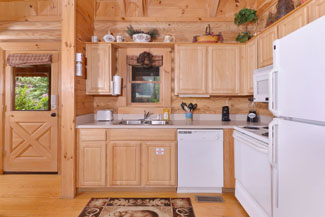 Pigeon Forge Cabin Rental that features a fully equipped kitchen.