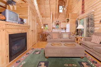 Tennessee Vacation Cabin Rental that features a nice seating area and television above the gas firplace