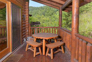 Pigeon Forge Cabin Rental Picnic table while relaxing on the covered porch.