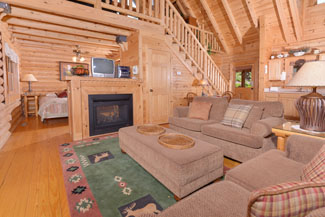 Pigeon Forge One Bedroom Loft Cabin Rental that features 2 living room areas and a year round hot tub.