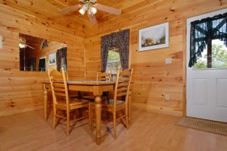 cabin with a dining area