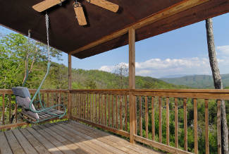 porch swin overlooking a mountain view