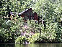 Pigeon Forge Cabin Rental that has access to a stocked fishing pond