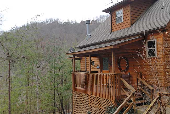 Pigeon Forge One Bedroom Plus Loft Cabin Rental that features a whirl pool, hot tub, and access to a private stocked fishing pond