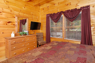 Private 7 bedroom cabin rental that features a king size bed in every bedroom and private flat screen television per bedroom