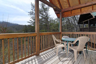 Tennessee Cabin Rental with outdoor rockers on a large covered deck overlooking the Smokies