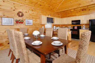 Pigeon Forge Cabin with a dining area overlooking the fully equipped kitchen and the living room