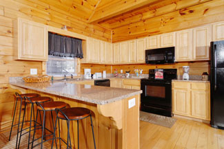 Pigeon Forge Cabin with a Fully Equipped Kitchen with a Dishwasher Microwave and Stove-Oven