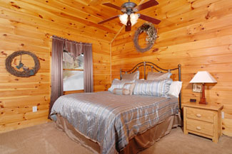 Pigeon Forge Seven Bedroom Cabin Rental with Two Master Suites that feature a private indoor whirlpool