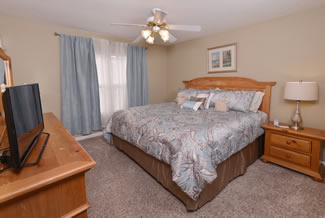Pigeon Forge Cottage Bedroom Master Suite with King Size Bed and Flat Screen Television