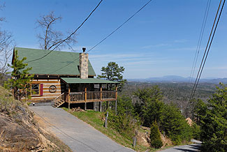 Pigeon Forge One Bedroom Plus Loft Cabin Rental featuring a King Size bed in the Bedroom with a Smoky Mountain Panoramic View