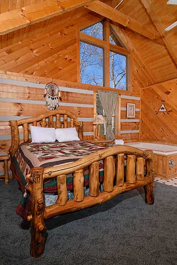 Storybook bedroom setting with log bed and whirlpool tub