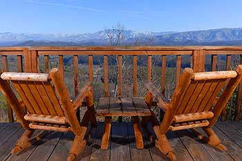 Deck table and chairs overlooking that incredible mountain view