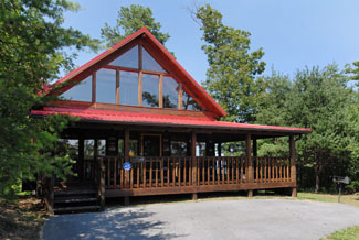 Pigeon Forge One Bedroom Plus Loft Cabin Rental with a Smoky Mountain View and a King Size bed in the Main Level Bedroom