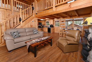 Pigeon Forge One Bedroom Plus Loft Livingroom Area that features a queen size sleeper sofa and recliner