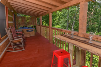 Pigeon Forge One BEdroom Plus Loft Cabin Rental Deck Area with Year Round Covered Hot Tub