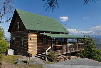 Pigeon Forge Log Cabin Rental with Panoramic Mountain View featuring a game table and hot tub