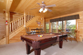 Tennessee Smoky Mountain Cabin Rental that features a lower level game room that has a pool table and plenty of seating for the whole family