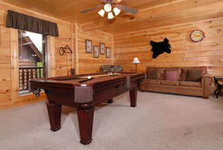 Pigeon Forge Cabin that features a sleeper sofa in the gameroom area