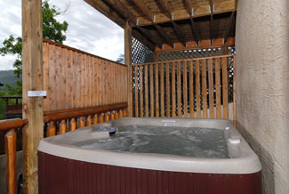 Pigeon Forge four bedroom cabin that features an outdoor hot tub
