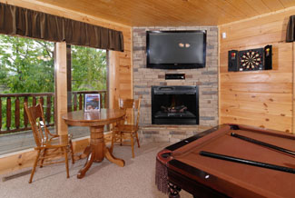Pigeon Forge Vacation Cabin Rental with pool table, flat screen, and card table.
