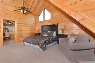 Pigeon Forge 4 Bedroom Cabin rental with a private master suite on the upper level.