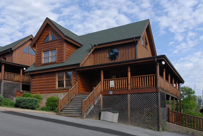 Pigeon Forge Pet Friendly Four Bedroom Cabin Rental near Dollywood with whirl pool hot tub pool table dart board Wii System Internet Access outdoor firepit