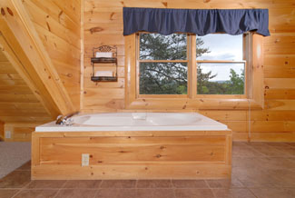 Pigeon Forge Cabin that features an indoor whirlpool in the upstairs master bedroom that has a mountin view